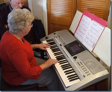 Barbara Powell enjoying Alan Wilkin's Yamaha PSR-900
