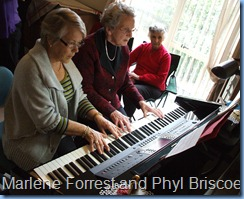 A study in concentration. Marlene Forrest (left) and Phyl Briscoe with a duet on the Clavinova whilst Ngaire Lonergan watches on.