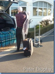 Peter Brophy unpacking his car at the Ocean Shores Village where the Concert took place.