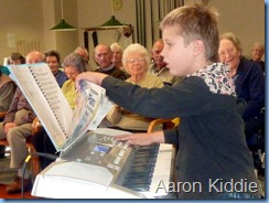 One of Carole Littlejohn's students, Aaron Kiddie, played three pieces for the Concert on his Casio keyboard. Photo courtesy of Colleen Kerr