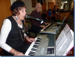 Carole Littlejohn is an accomplished singer as well and here you see her singing along with the keyboard playing