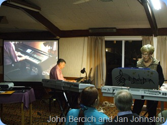 Another view of John Bercich and Jan Johnston duetting. The big screen was focussed on John playing our Clavinova