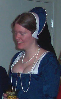 Closer view of hood, pearls and brooch
