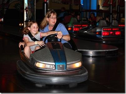 Elena and Heather riding a bumper car at Luna Park