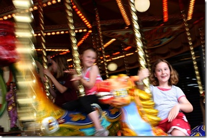 Lucy and Elena on carousel at Luna Park