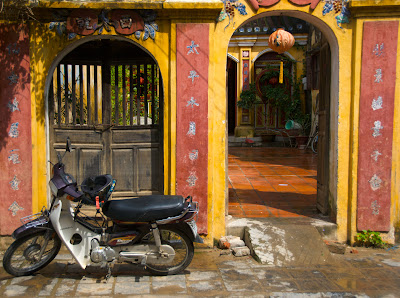 Hoi An motorcyle outside yellow door