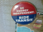 "a button that reads ""Be Energy Independent! RIDE TRANSIT"""