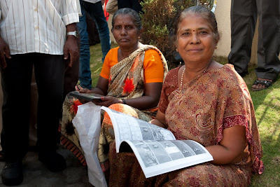 Two Deaf Indian ladies looking at the sign language storyboard book