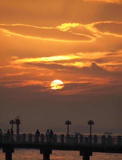 Scene: Gu Lang Yu (Sights & Buildings) of people and sunsets