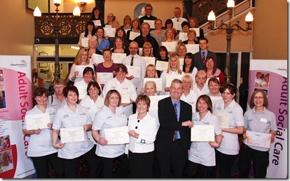 Sandra Shorter Head of Care4CE and Phil Lloyd Director of Adults, Community, Health and Wellbeing with Care4CE staff who were presented with achievement awards at Macclesfield Town Hall