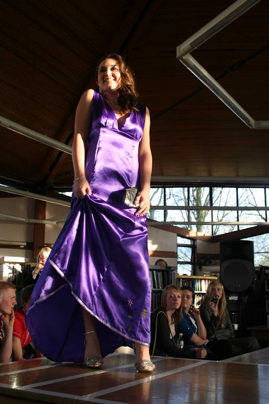 Amy model her long slinky gown inspired by romantic novels