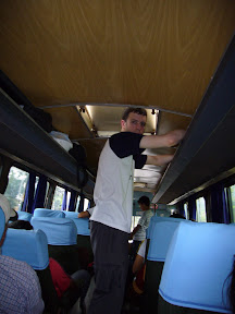 Aisle surfing like a boss.  This bus was easy, there was added headroom so that I could standup straight! Possible downside: skull getting crushed when the bus rolls over.