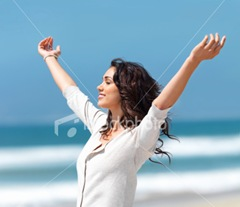 ist2_6244050-pretty-young-woman-with-arms-raised