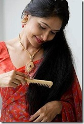 woman brushing her tresses