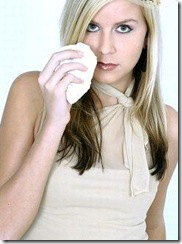 woman taking a whiff of essential oil from her hanky