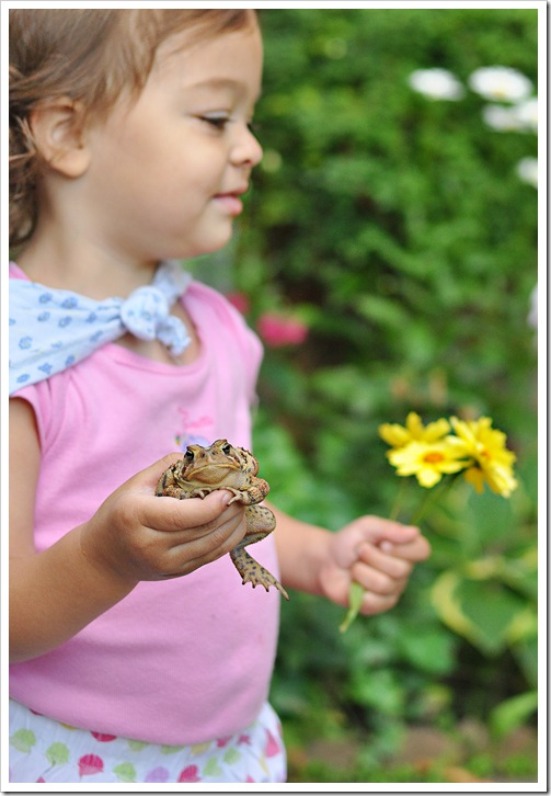 ella with toad and flowers
