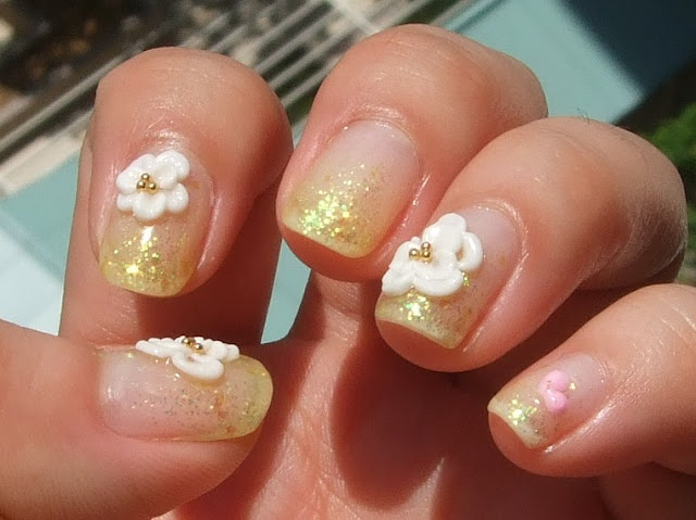 made the acrylic flowers separately and stuck them onto the nails a