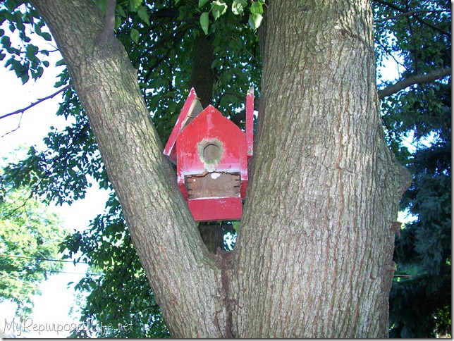 old red birdhouse