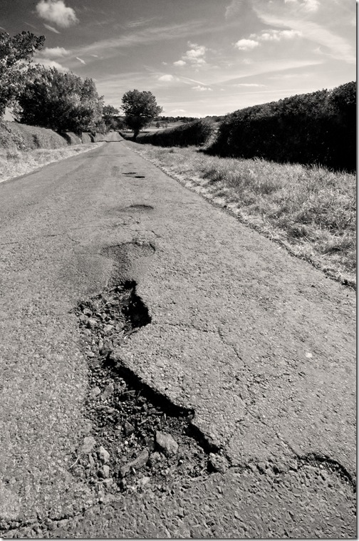 country lane with damaged tarmac