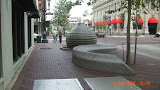 Artist created carved stone fountain and bench. Note mechanical  vault hatch in foreground.