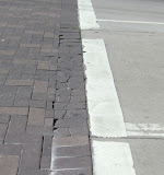 Traffic moves from the left to the right. Note space between pavers is excessive due to shift to the left due to vehicle thrust.
