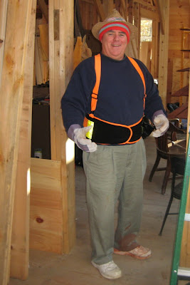 Pop all ready to work on some siding. Note the mark of the house on the left shoe.