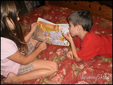 Sister reading to Brother