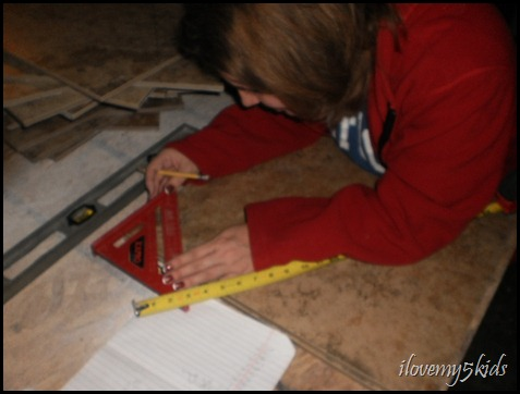 Measuring tile.