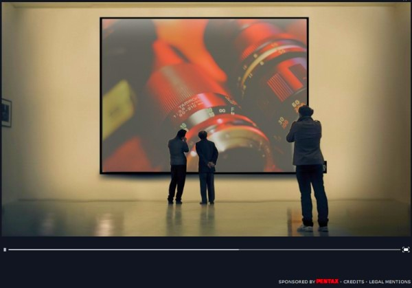 Screen snap from a Pentax ad featuring 1 Snap Music! photography.