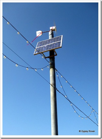 Energy saving at Paignton. Solar panels and wind turbines power the beach light's.