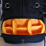 This is the camera compartment. Bright yellow so that you can spot even the smallest accessory. This padded area can also be removed to turn the bag into a normal backpack