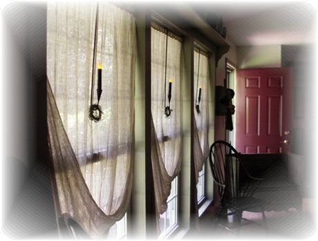 Sconces on front windows