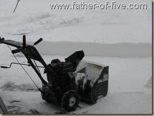 Snow blower - you can see the snow depth in the background.
