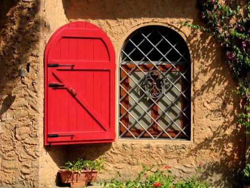 Tuscany shuttered window