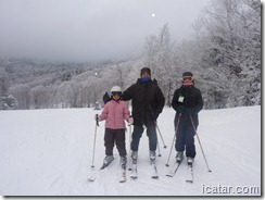 Annalise, Roneil, and Julianne at the top of the mountain