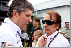 (L to R): Nick Fry (GBR) Mercedes GP Chief Executive Officer with Emerson Fittipaldi (BRA) FIA Race Steward.