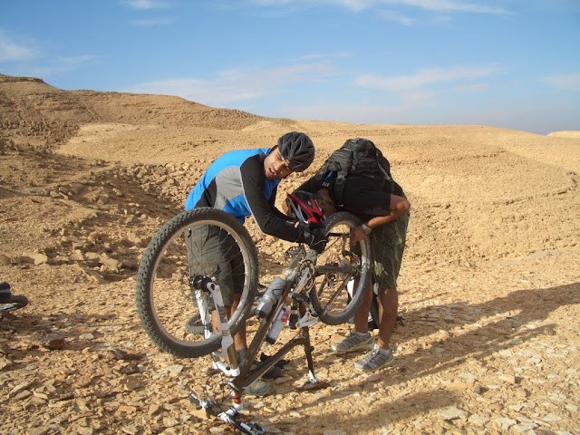 ...a flat that became a recurring theme throughout our trip. Nothing short of excorsism would rid Samer of the demonic rear tire that just loved to go flat every time Saemr started having some fun on his bike. While Kandil helped Samer out...