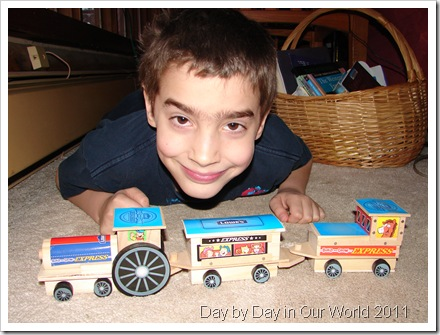 R poses with his train set