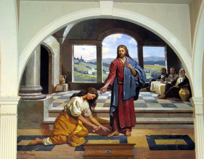 Woman washing Jesus' feet