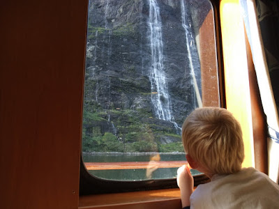 My son looking out at the waterfall the seven sisters