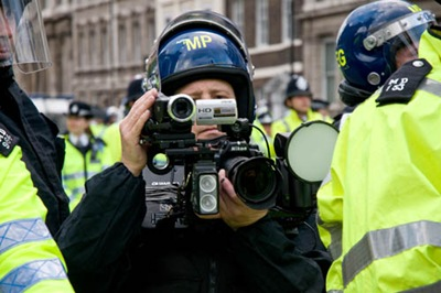 "LONDON, UNITED KINGDOM - 15.06.08. A police photographer in full riot gear films and photographs protesters, during a demonstration against George W Bush during the U.S President's visit to London on Sunday 15 June 2008, London, England.  Protesters had been ""banned"" by the police from demonstrating outside 10 Downing Street to protest against the wars in Iraq and Afghanistan. (Photo by Marc Vallée/marcvallee.co.uk) (c) Marc Vallée, 2008."
