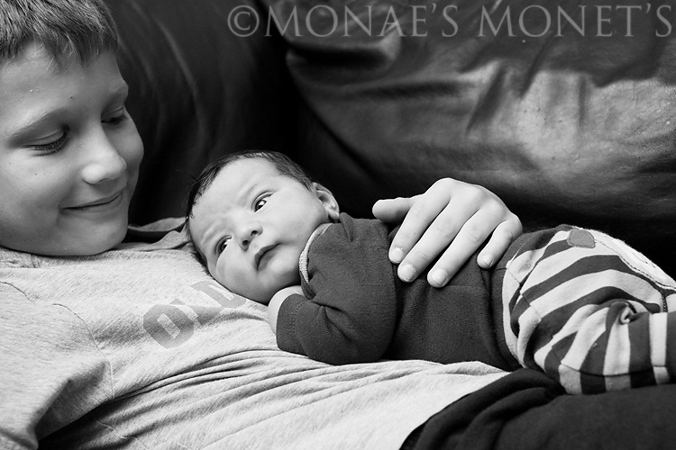 Austin holding ryan on chest black and white blog