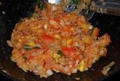 fry tomato till mushy