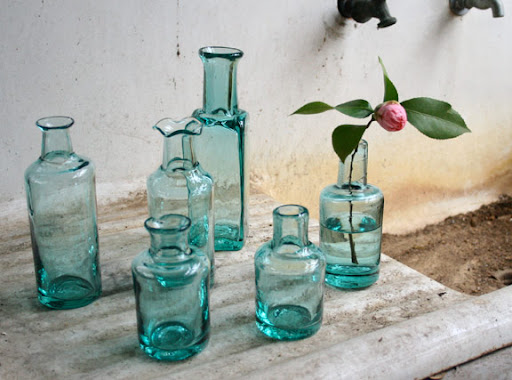 Glass bottles as bud vases