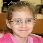 Princess T trying on frames for her lenses.