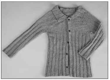 A half-ribbed raglan cardigan has an easy-fitting neck.