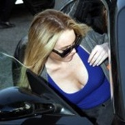 lindsay_lohan_-_nice_cleavage_in_blue_topjeans_entering_car3-150x150