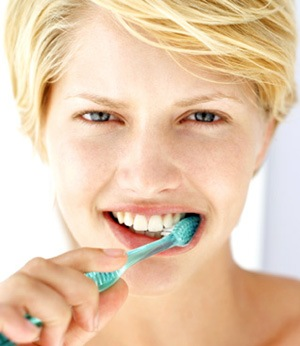 lady brushing teeth