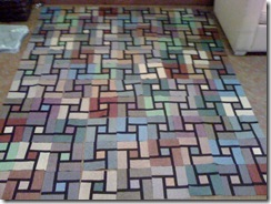 Started out as Strip Twist, I turned it into something completely different.  Just need to assemble the quilt top.