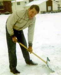 Clayn shoveling snow